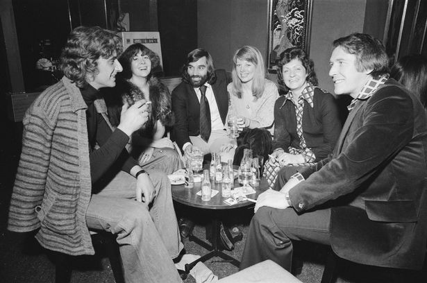 Footballer  George  Best  with  friends  at  his  night  club  Slack  Alice  in  Manchester.  4th  February  1976